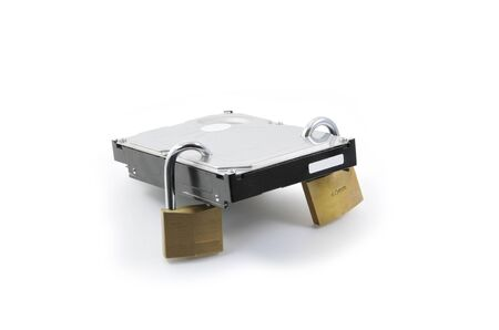 Hard disk back view with two locked padlocks on a white background Stock Photo - 8719044