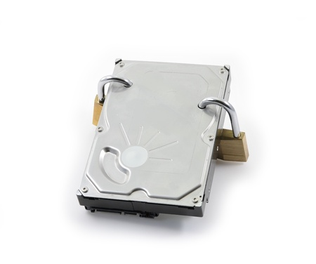 Hard disk front view with two locked padlocks on a white background Stock Photo - 8719046