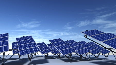 Field of articulated solar panels with morning light and a blue sky with some cirrus clouds