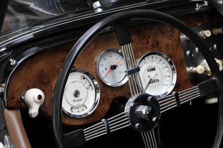 coachwork: Old wood dashboard of a black Morgan car