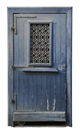 Dusted wood door painted in blue with wrought iron on a window and with a white background photo