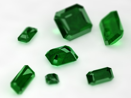dept: Seven Emeralds with thin dept of field on a white background Stock Photo