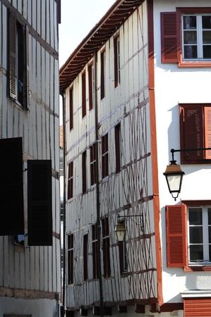 bask: Little Space between Two Typical Red and White Bask Buildings