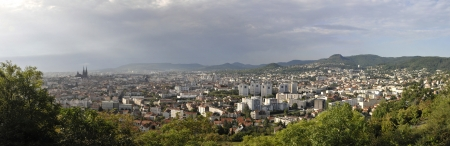 Panoramic View of Clermont-Ferrand City with a Cloudy Sky