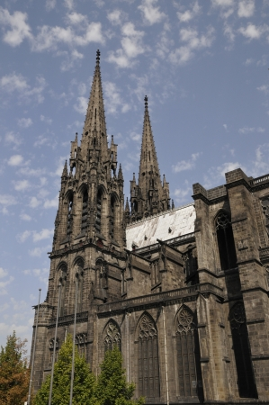 Side View of the Cathedral of Clermont-Ferrand with a blue sky