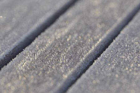 dept: Frost on little wood planks with a thin dept of field Stock Photo