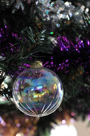 Transparent Christmas Ball in an artificial Pine Stock Photo