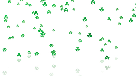 sweet seventeen: Some Tiny Green Clovers with a White Background Stock Photo