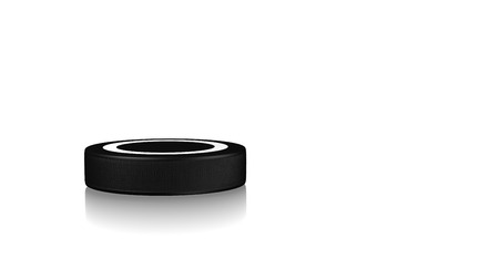 hockey goal: Close up on an Ice Hockey Puck on a reflecting white floor Stock Photo