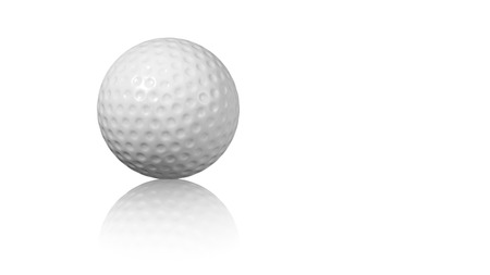 Close up on a Golf ball on a reflecting white floor