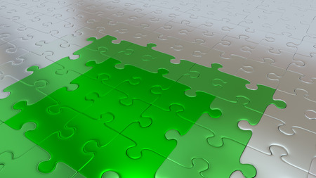 Some Silver Puzzle Pieces on all other the floor becoming Green pieces 스톡 콘텐츠