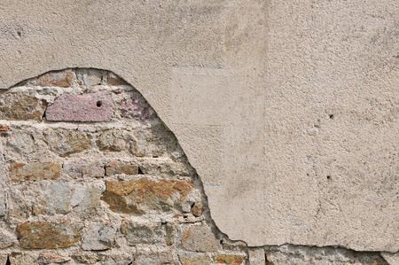 Close-up of an Irregular Old Stones Wall with cracked roughcast Banco de Imagens