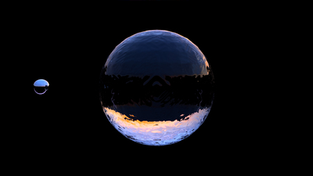 Large Water Ball with a small Chrome ball on a Black Background