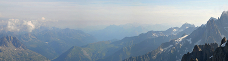 Panoramic view from Aiguille du Midi mountain of a valley in the french Alps