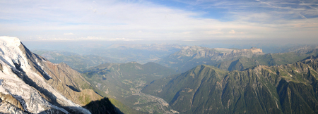 Panoramic view from Aiguille du Midi mountain of the french Chamonix Valley in Alps