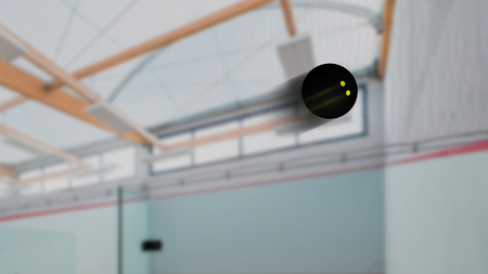 Squash ball snapshot with speed blur effect inside a pitch Stock Photo
