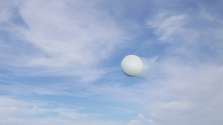 Golf ball snapshot with speed blur effect on a blue sky background Stock Photo