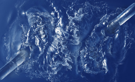 Two Large Water Jets splashing in a dark blue Liquid with foam and many waves Kho ảnh
