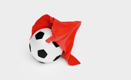 A Red Fabric piece finishing to take One Football out with a White background Stock fotó