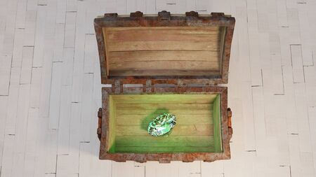 Top view of an old wood with rusty metal Chest  put on a white wood floor and opened with a very big green diamond inside