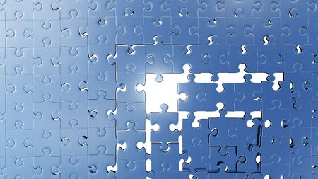 Top View of many puzzle pieces almost placed with a white background