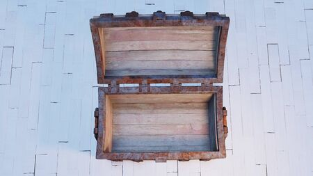 Top view of an old wood with rusty metal Chest totally Opened and empty put on a white wood floor