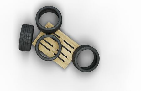 Top view of Four Large Sport Tire in a mess on a wood pallet with a white background Banco de Imagens