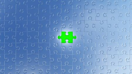 One Large Green piece of puzzle in place in the center of many other pieces with a white background