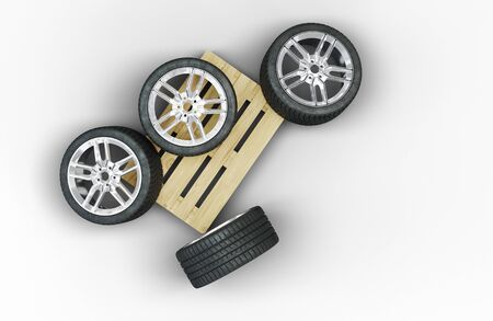 Top view of 4 Large Sport Wheels in chaos on a wood pallet with a white background Banco de Imagens