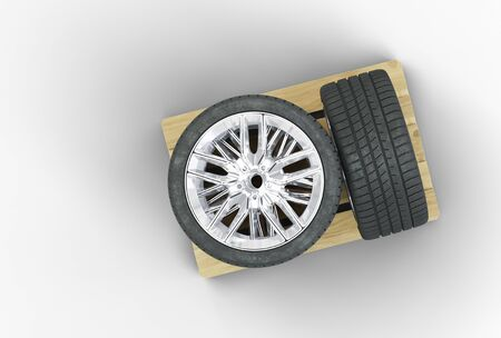 Top view of 4 Large Sport Wheels straight loaded on a wood pallet with a white background