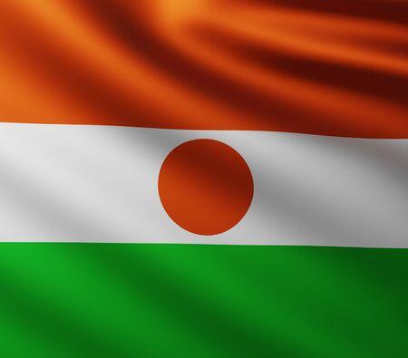Large Flag of Niger fullscreen background in the wind with wave patterns Reklamní fotografie