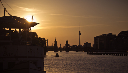 Sunset city view of TV tower and Oberbaum bridge near river Spree. Kreuzberge, Friedrichshain
