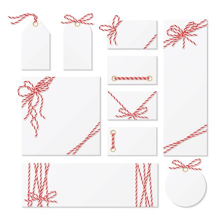 Set of cards, tags and labels tied up with red bakers twine bows and ribbons