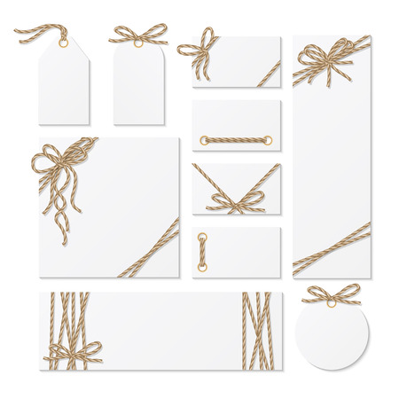 Set of cards, tags and labels tied up with rope bows and ribbons