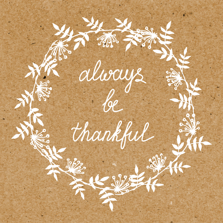 thankful: Greeting card with white wreath and thankful inscription on cardboard background Illustration