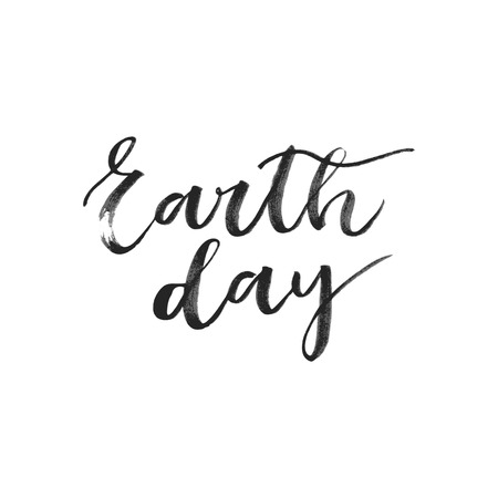 superscription: Earth day black ink written inscription on white background