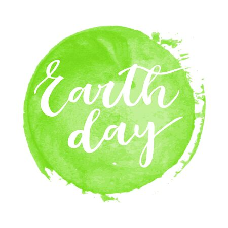superscription: Earth day white written inscription on green round watercolor background