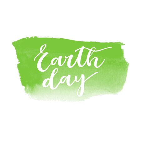 superscription: Earth day white written inscription on green watercolor background