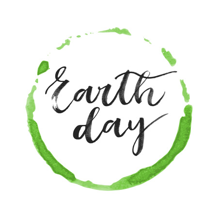superscription: Earth day black written inscription on green round watercolor background Illustration