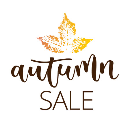 disposition: Autumn sale hand written inscription with fall chestnut leaf on white background
