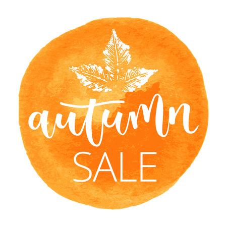 Autumn sale white hand written inscription with chestnut leaf on orange round watercolor background