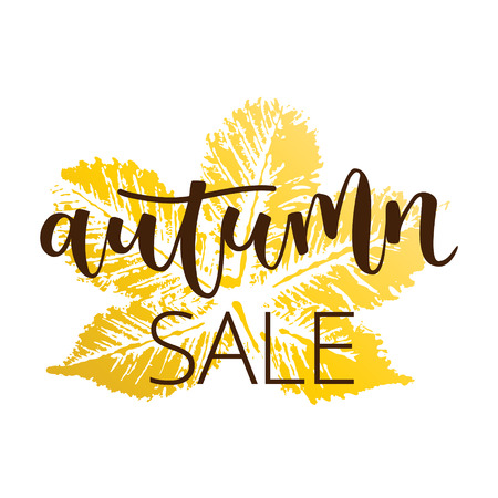 Autumn sale hand written inscription with fall chestnut leaf on white background