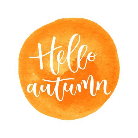 Hello autumn hand written inscription on orange round watercolor background