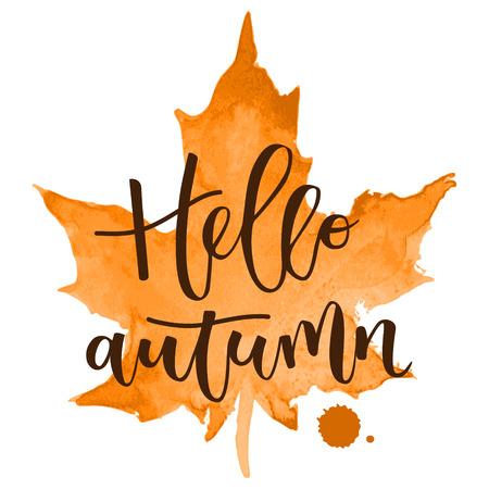 Hello autumn hand written inscription with orange watercolor maple leaf