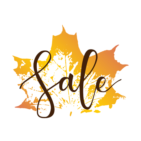 Sale hand written inscription with fall maple leaf on white background
