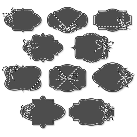 twine: Set of chalkboard vintage labels and frames tied up with black bakers twine bows and ribbons on white background Stock Photo