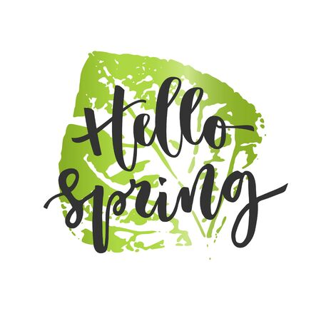 Hello spring hand written inscription with a leaf on the background