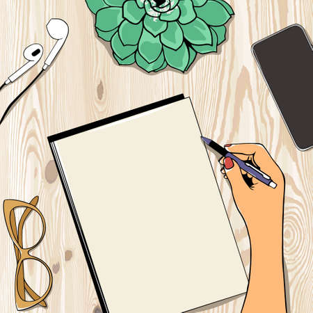 Top view of girl's hands writing in notepad with copy space, placed on wooden desk with mobile phone, flower, headphones and glasses. Mock up Vetores