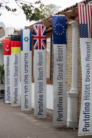 Inscriptions with flags at the entrance to the restaurant in the resort area