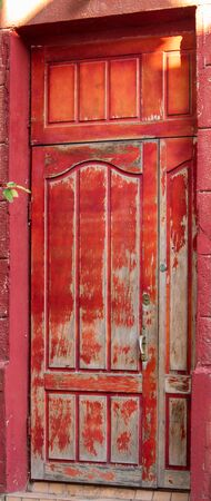 Red old door with old paint